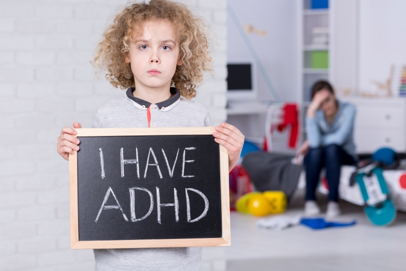 Boy-holding-blackboard-that-says-i-have-adhd-marijuana-pot-weed-for-kids-with-adhd